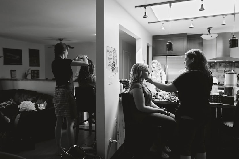bride and bridesmaids getting ready at house