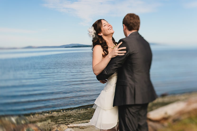 laughing bride at oceanfront beach