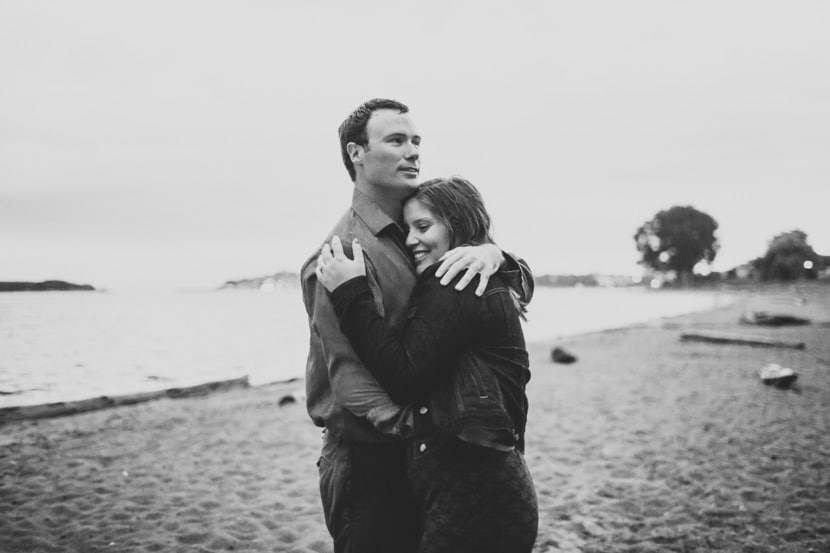 A soggy hug between the engaged couple at Willows Beach in Oak Bay