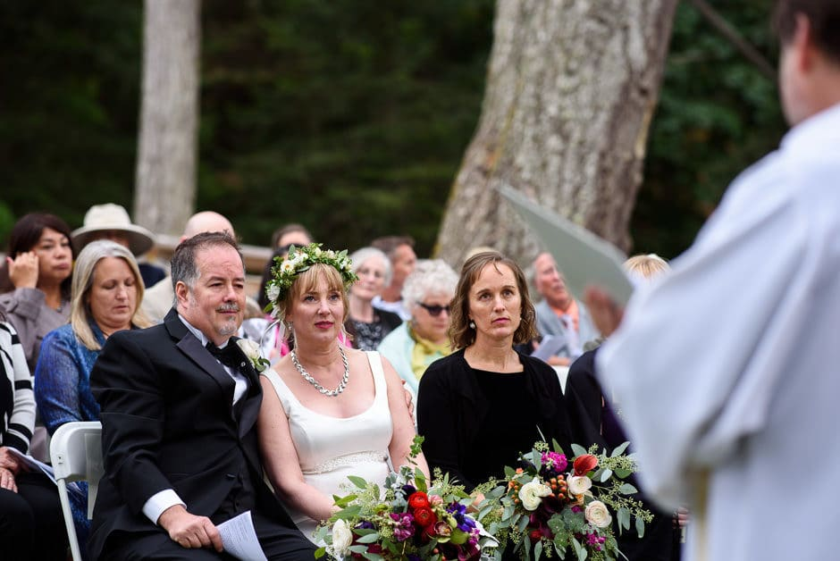 couple emotionally listening to wedding ceremony
